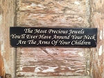 The Most Precious Jewels You'll Ever Have Around Your Neck Are The Arms Of Your Children.  Wood Sign